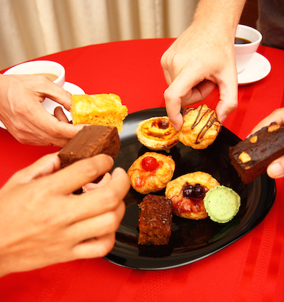 Group Of Friends Sharing A Lot Of Cakes And Pastries